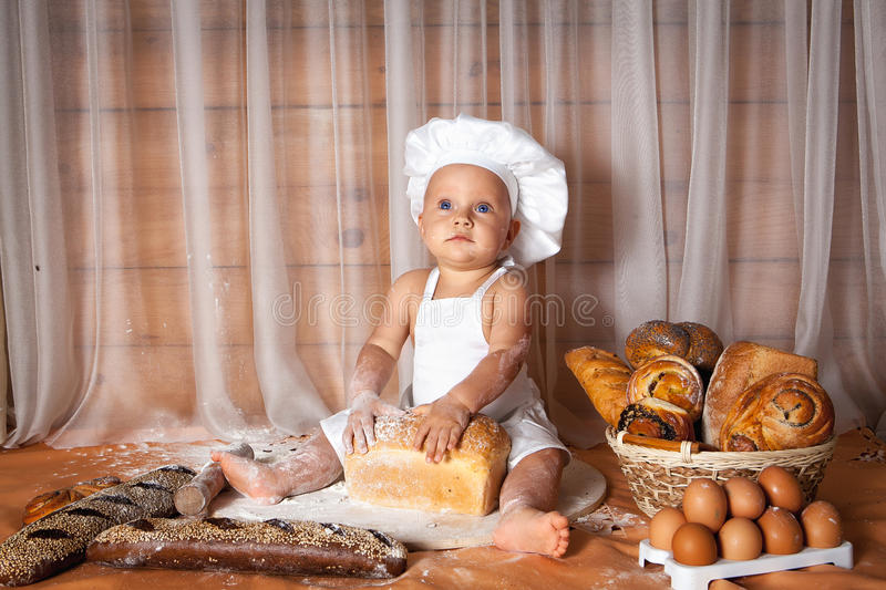 happy-baby-baker-sitting-surrounded-bread-pastries-75180553